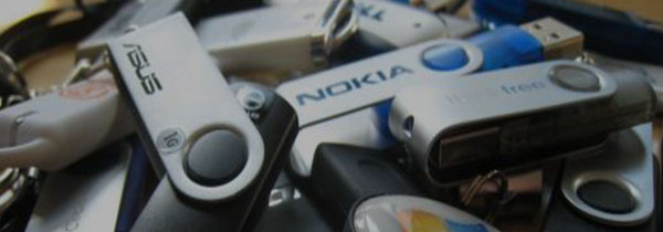 Know Your Assets Pile USB Drives